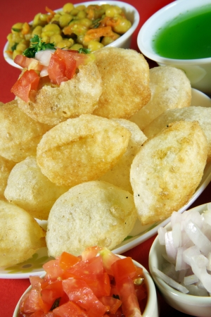 pani: Close-up of puri and other ingredients of pani puri Stock Photo