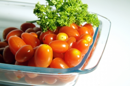Close up of tomatoes and coriander in a tray photo