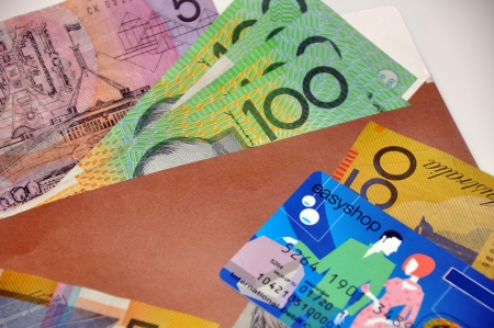 Close-up of australian currency and a debit card photo