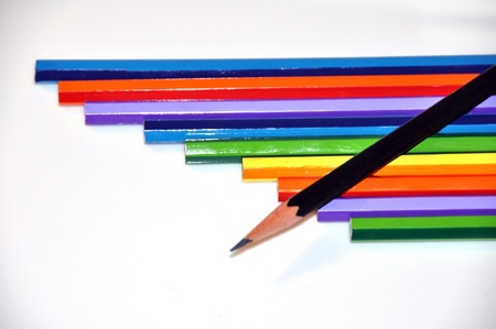 Close-up of pencils on white background photo