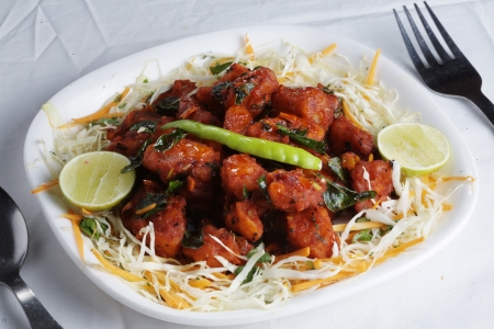 paneer: Chilli Paneer served in a plate
