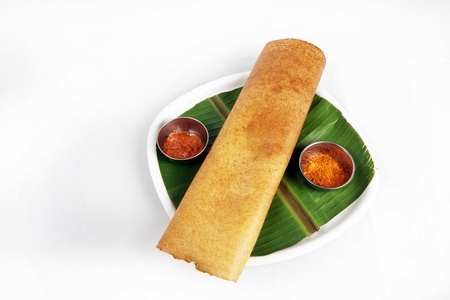 Indian breakfast dosa served in a plate photo