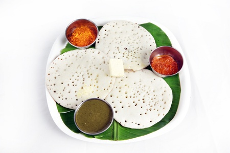 Kerela dish appam served in a plate photo