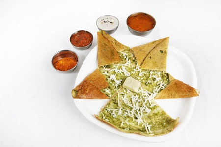 Indian breakfast masala dosa served in a plate photo