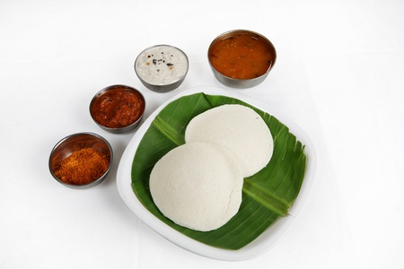 Indian breakfast Idli served in a plate photo