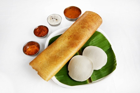 South Indian breakfast idli and dosa with chutney served in a plate photo