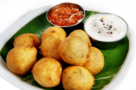 South Indian breakfast snacks,Bondas served in a plate Stock Photo
