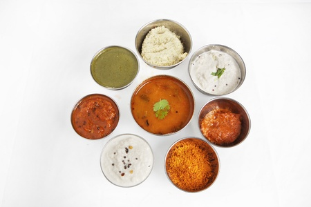 Variety of curries arranged in bowls