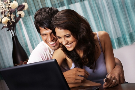 Couple shopping online on a laptop
