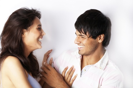 Portrait of young couple laughing photo