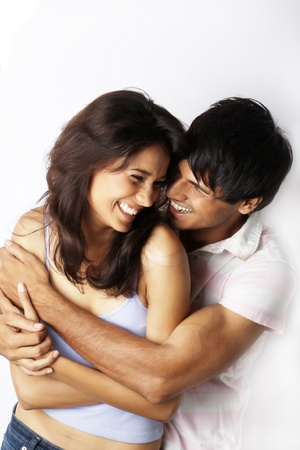 couple cuddling: Portrait of young couple laughing