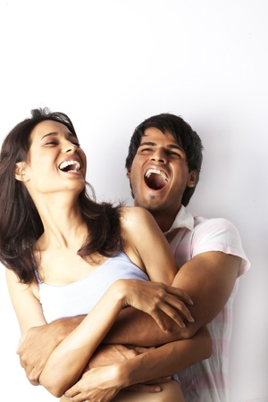 waist up: Portrait of young couple laughing