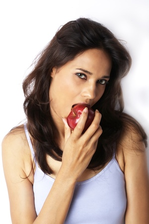 eat right: Close-up of a young woman eating red apple