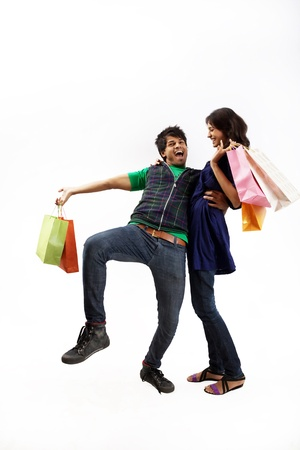 Young couple with shopping bags photo