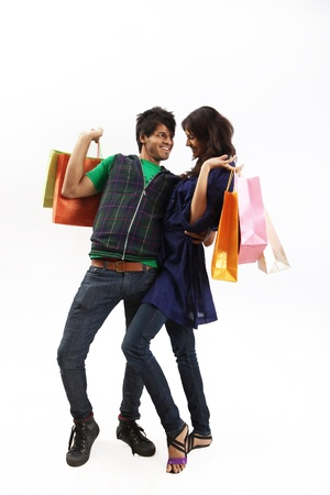 Young couple posing with shopping bags photo