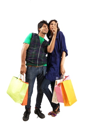 Young couple posing with shopping bags Standard-Bild