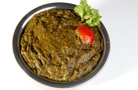 ka: Sarson ka saag garnished with tomato and coriander leaves Stock Photo