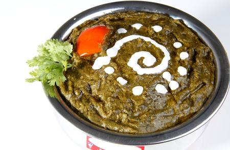Close-up of sarson ka saag garnished with butter photo
