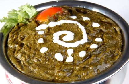 ka: Close-up of sarson ka saag garnished with butter