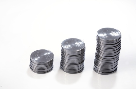 Coins arranged in stacks against white background
