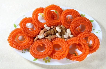 Indian Traditional sweets jangri and dry fruits photo