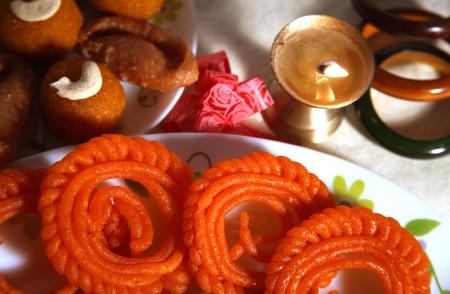 Close-up of Diya and sweets photo