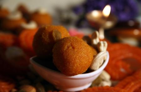 Close-up of Diya and traditional sweets photo