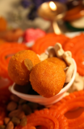 indian cookery: Close-up of Diya and sweets Stock Photo