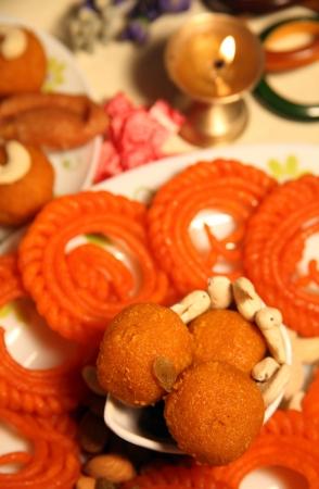 Close-up of Diya and sweets Stock Photo