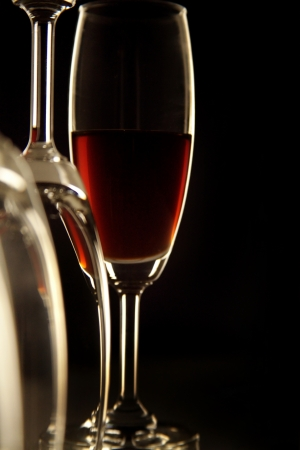 Close-up of glass of wine and empty glass