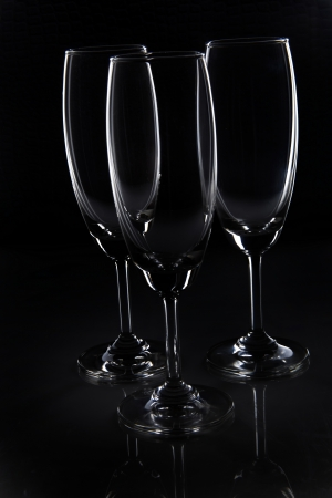 Close-up of three empty wine glasses