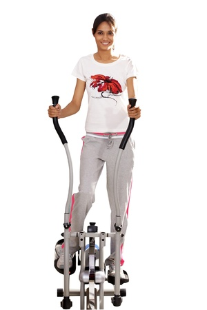 Young woman doing exercise on exercise cycle