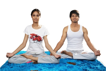Young man and woman practicing yoga photo