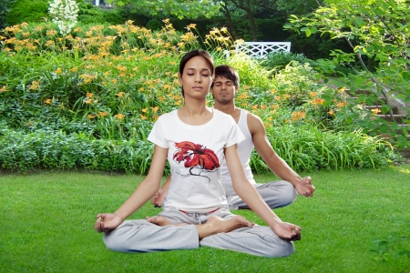 Young man and woman practicing yoga