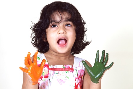 Portrait of a young girl with colored palms photo
