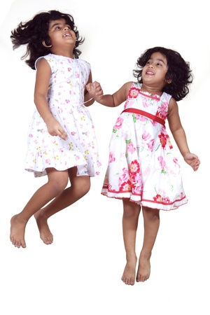 Portrait of young girls jumping Stock Photo