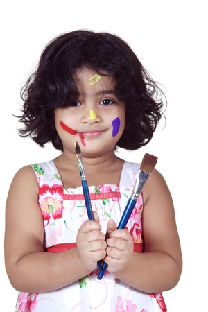 Portrait of a girl with paint brushes