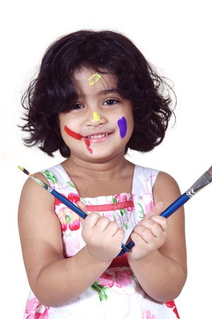 Portrait of a girl with paint brushes photo