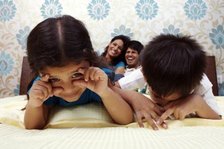 Family having fun in the bedroom