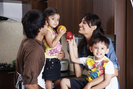 Family having fun in kitchen photo