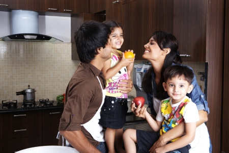 Happy Family in kitchen photo