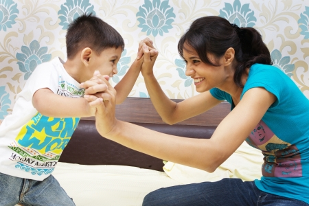 kid friendly: Mother and son having fun fight
