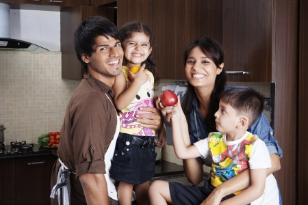 asian indian: Family having fun in kitchen