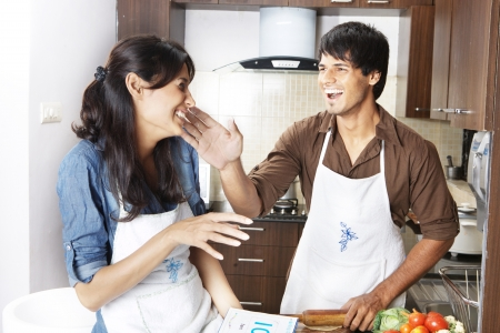 Couple cooking in the kitchen Stock Photo
