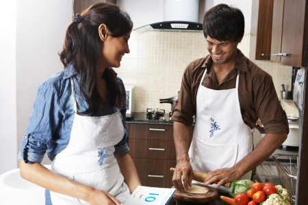 Couple cooking in the kitchen photo