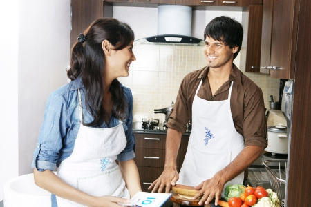 Couple cooking in the kitchen Stock Photo - 21399796