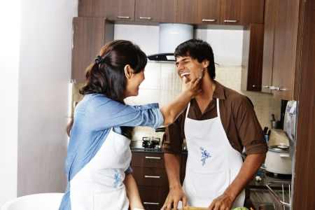 Happy Couple  laughing in kitchen photo