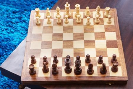 Chess battle on wood board Standard-Bild