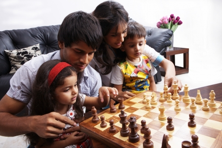 nuclear family: Portrait of a family playing chess