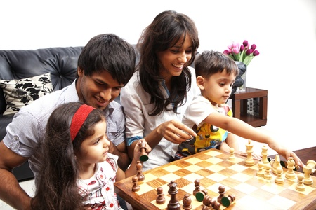 Portrait of a family playing chess Stock Photo - 21399837